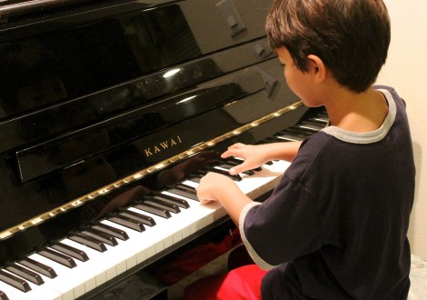 Child Taking Piano Lessons